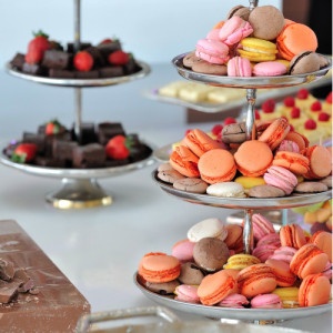A Selection of friandise. nougat, macaroons, brownies, short cakes and fresh strawberries.