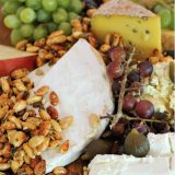 Cheese board with seadless grapes and nuts