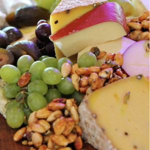 Cheese board with nuts and fresh fruit