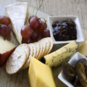 Cheese Board with Crackers, Fresh Fruit, Figs and Caramelized Onion