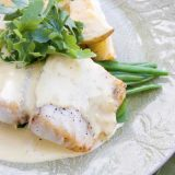 Baked linefish with seasonal greens, potato wedges and hollandaise sauce