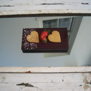 Biscuit on mirror with fresh strawberries