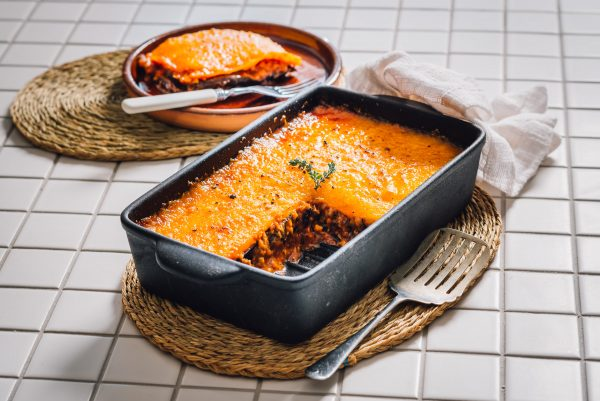 The classic eggplant and tomato ragu bake from Naples, Melanzane alla Parmigiana, being plated up.