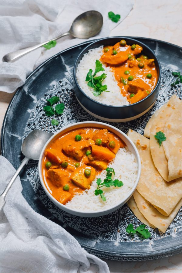 Butter chicken, basmati rice, and flaky rotis