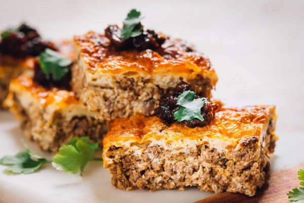 A classic Cape Malay bobotie, cut into squares for serving.