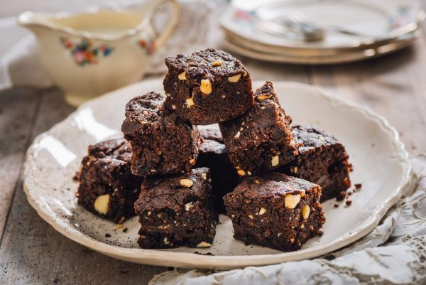 A plate of dark chocolate and pecan nut vegan brownies