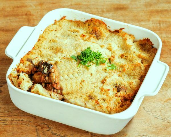 """An oven casserole dish containing a wild mushroom, aubergine & lentil """"shepherd's pie"""" with a cauli mash topping"""